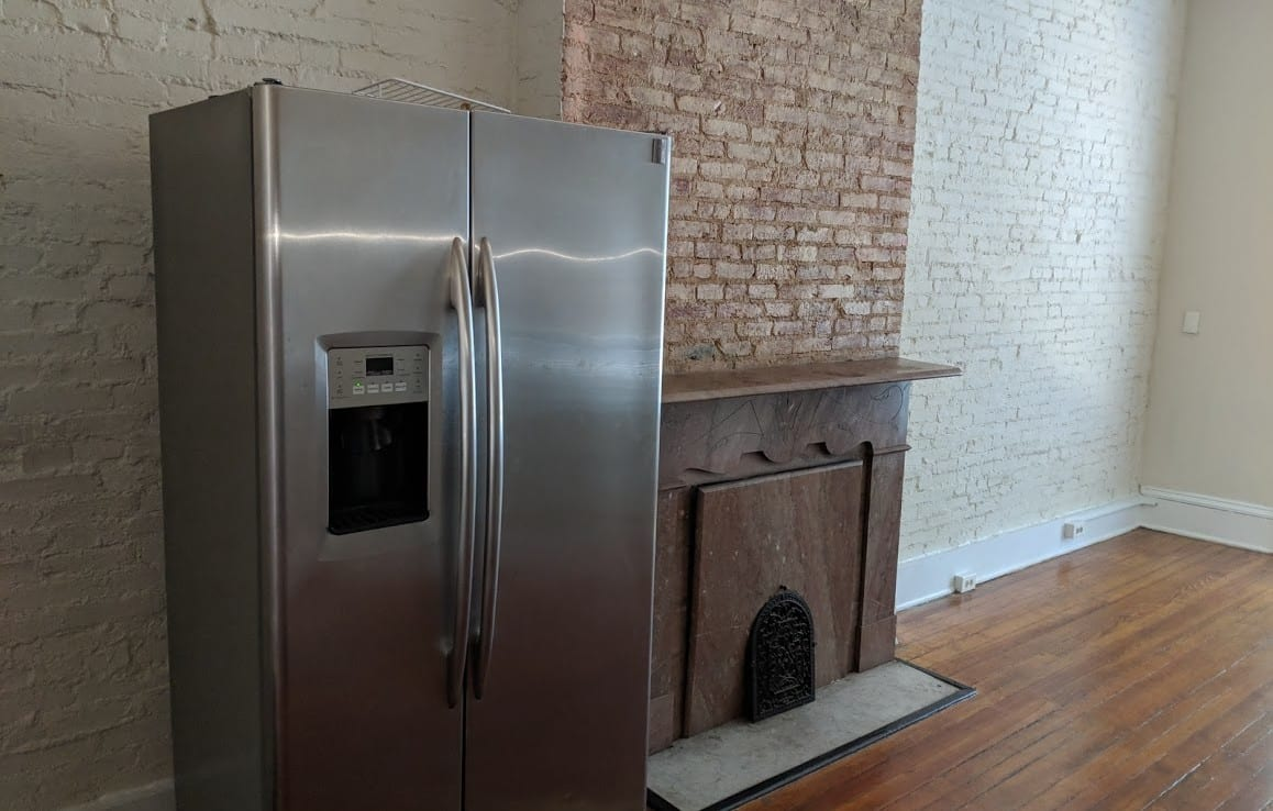 living room with refrigerator